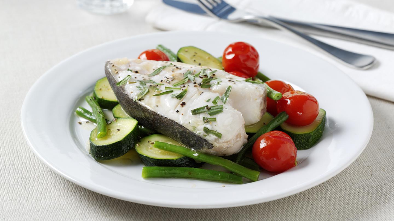 Tarragon-baked halibut with summer vegetables